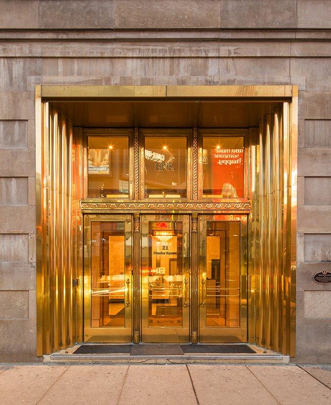 Gold art deco door entrance to 21 Dundas Square