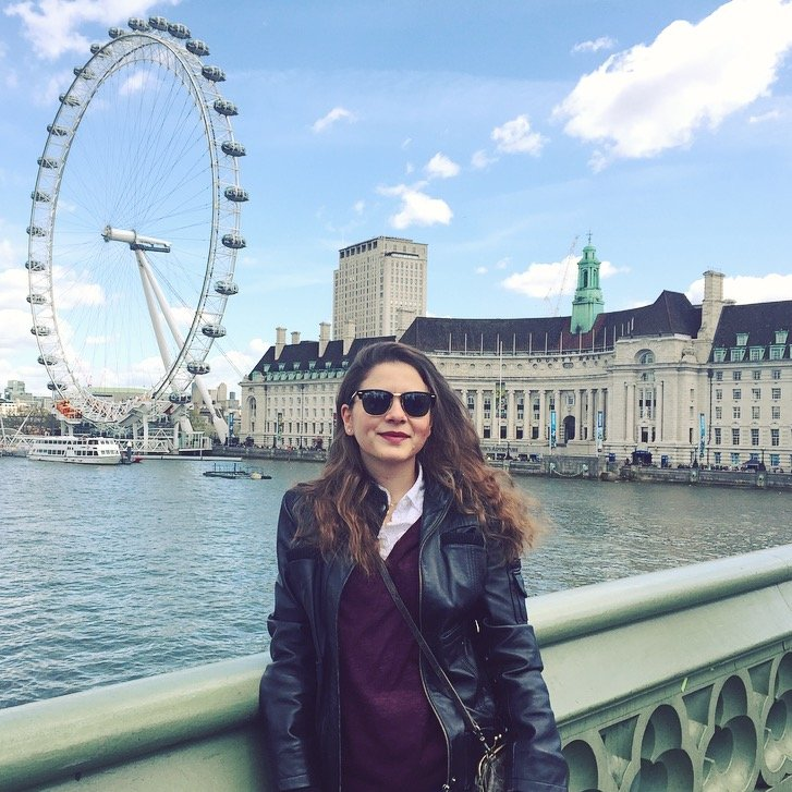 Ghida Abouzahr standing in front of the London Eye